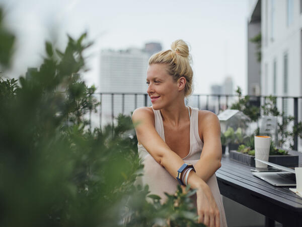 Woman stretching on balcony after a workout